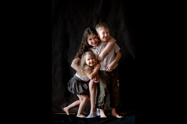 Children portrait in studio low key
