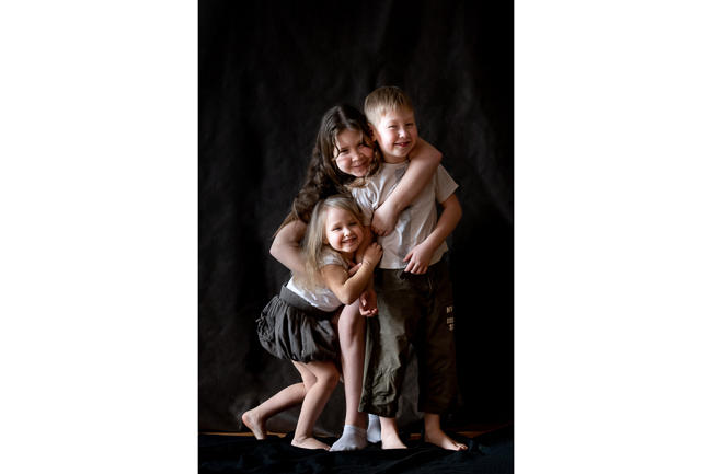 Children portrait in studio low key